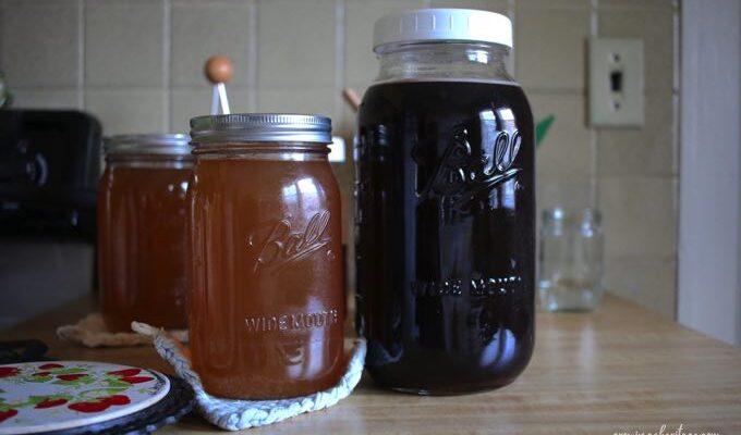 Bone broth and elderberry in large quart and half gallon mason jars